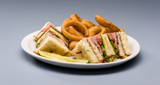 Club Sandwich & Onion Rings from an Ann Arbor Restraunt Near Me